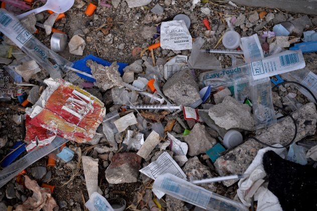 Needles used for shooting heroin and other opioids along with other paraphernalia litter the ground in a park in the Kensington section of Philadelphia, Pennsylvania, U.S. October 26, 2017.