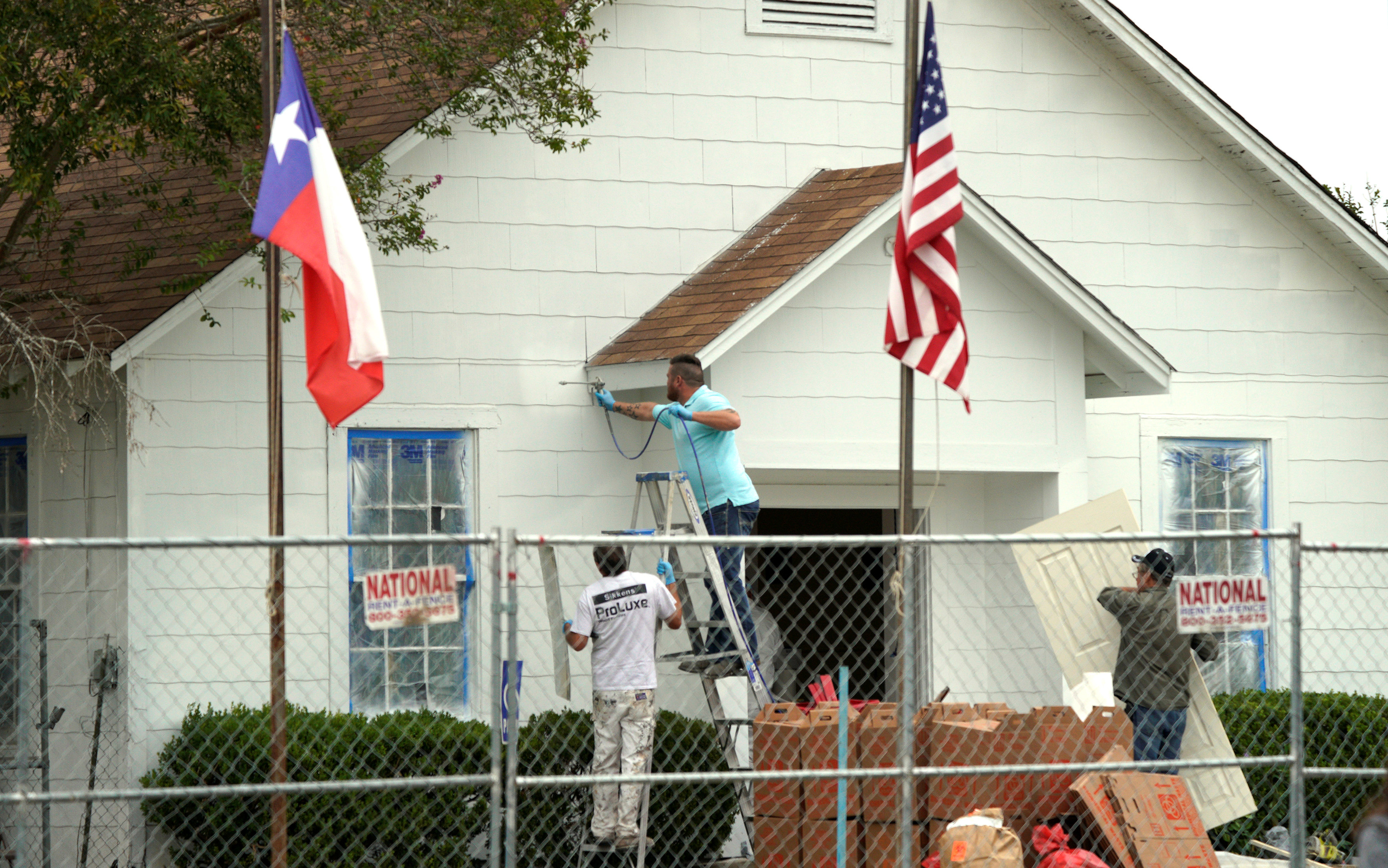 Workers make repairs and paint the site of the shooting at the First Baptist Church of Sutherland Springs, Texas, U.S. November 9, 2017