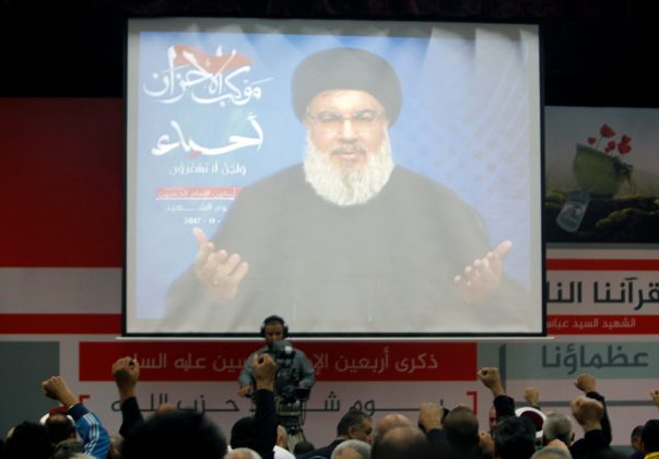 Lebanon's Hezbollah leader Sayyed Hassan Nasrallah is seen on a video screen as he addresses his supporters in Beirut, Lebanon November 10,