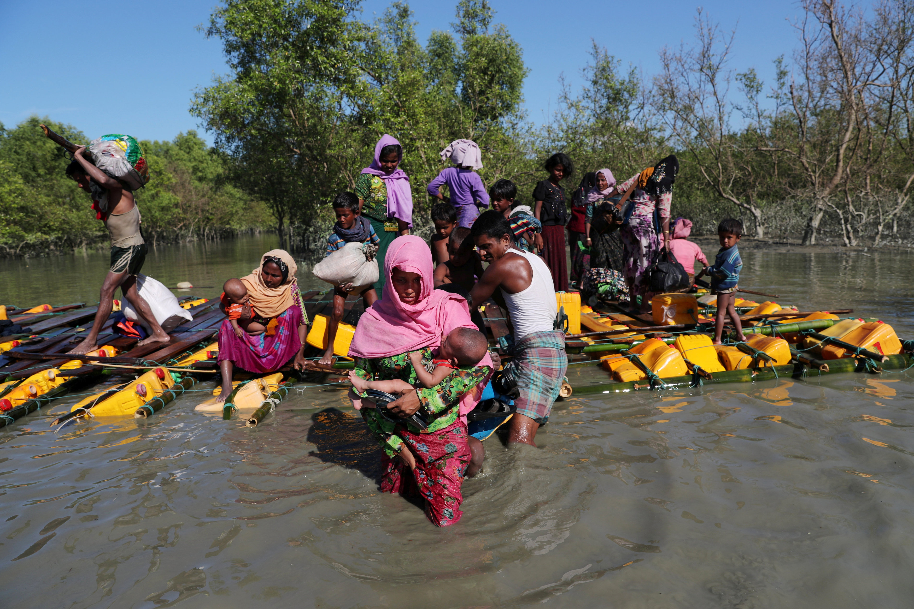Aboard rickety boats or swimming, over 750 Rohingya reach Bangladesh