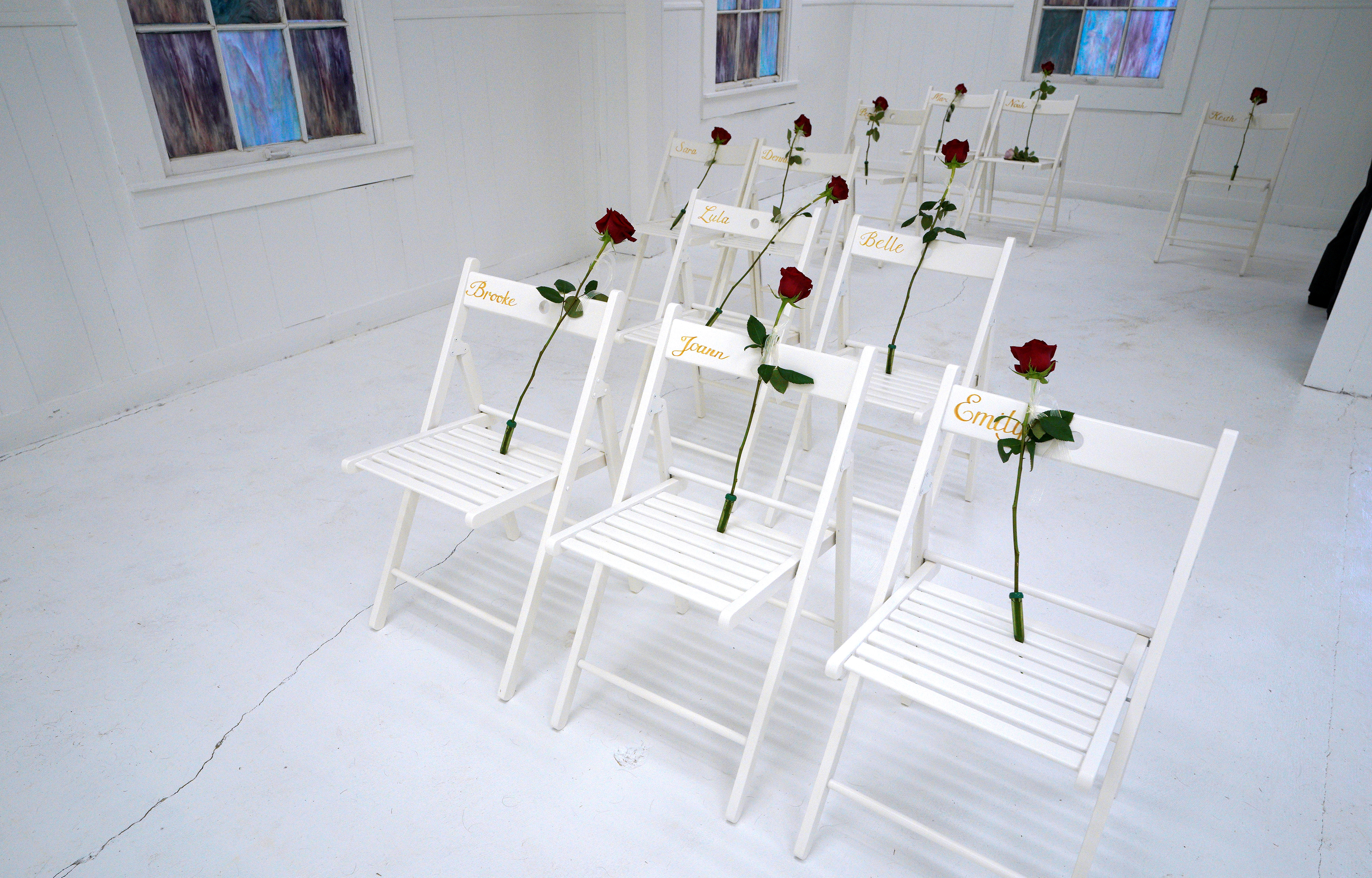 Chairs and roses show where Joann and Brooke Ward and others were found dead at the First Baptist Church of Sutherland Springs where 26 people were killed one week ago, as the church opens to the public as a memorial to those killed, in Sutherland Springs, Texas, U.S. November 12, 2017.