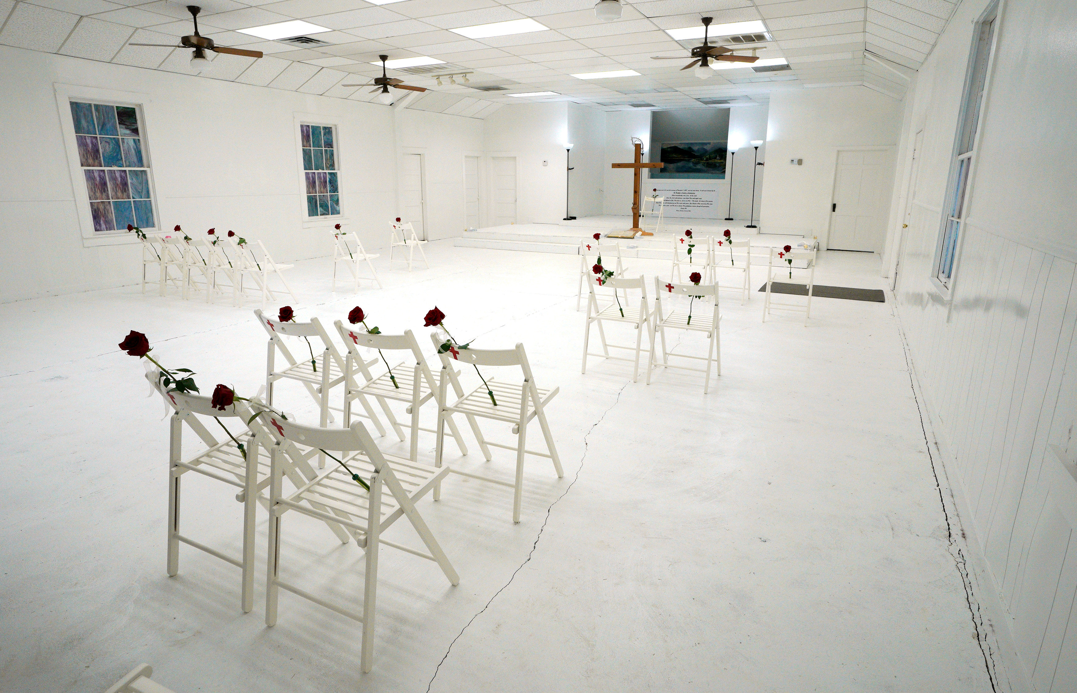 Chairs and roses mark where worshipers were found dead at the First Baptist Church of Sutherland Springs where 26 people were killed one week ago, as the church opens to the public as a memorial to those killed, in Sutherland Springs, Texas, U.S. November 12, 2017.