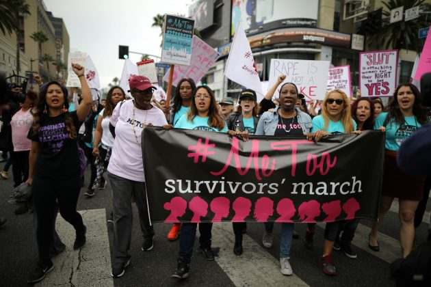 People participate in a protest march for survivors of sexual assault and their supporters in Hollywood, Los Angeles, California U.S. November 12, 2017.