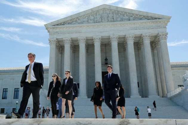 Appeals court lets Trump travel ban go partially into effect
