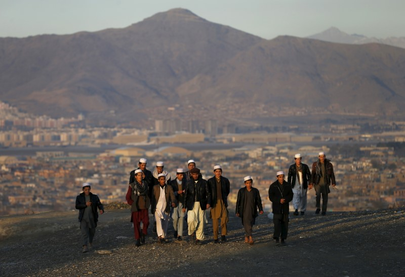 People climb up a hill to watch the sunset in Kabul, Afghanistan November 16, 2015. REUTERS/Mohammad Ismail