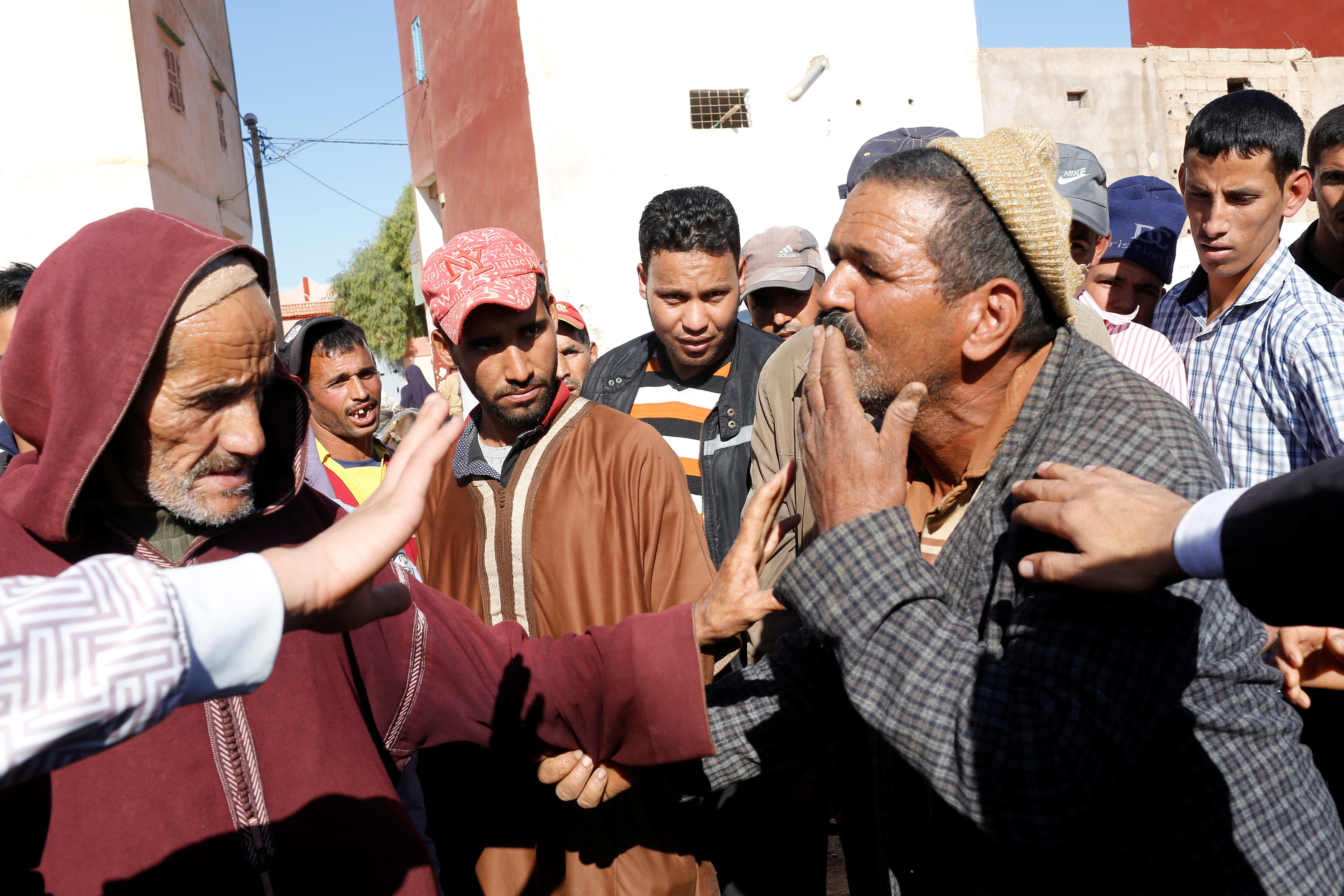People gather at the place where 15 people were killed when a stampede broke out in the southwestern Moroccan town of Sidi Boulaalam as food aid was being distributed in a market, in Sidi Boullaalam, Morocco November 20, 2017.