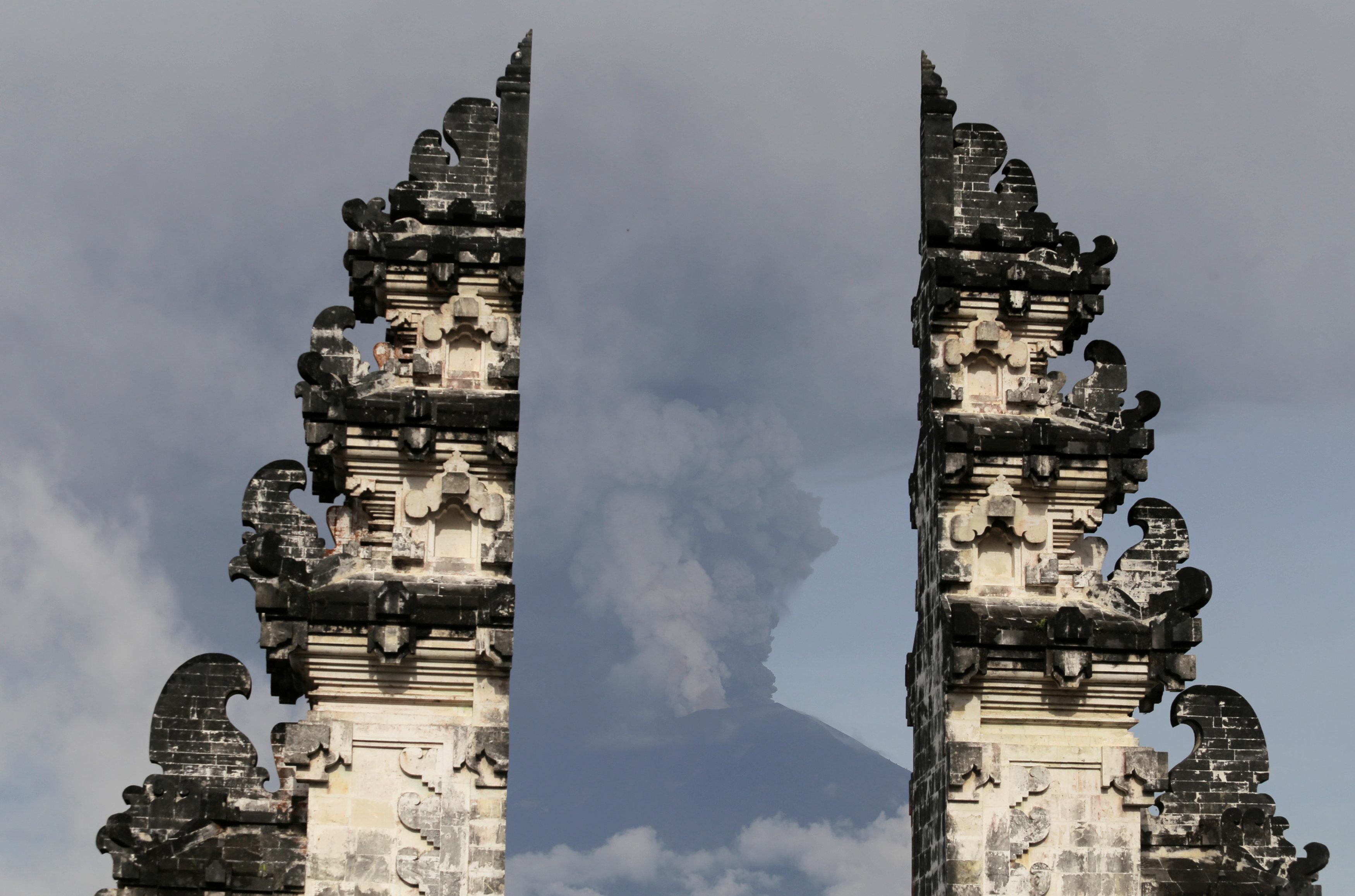 Mount Agung volcano is seen erupting from Lempuyang Temple in Karangasem, Bali, Indonesia November 27, 2017.