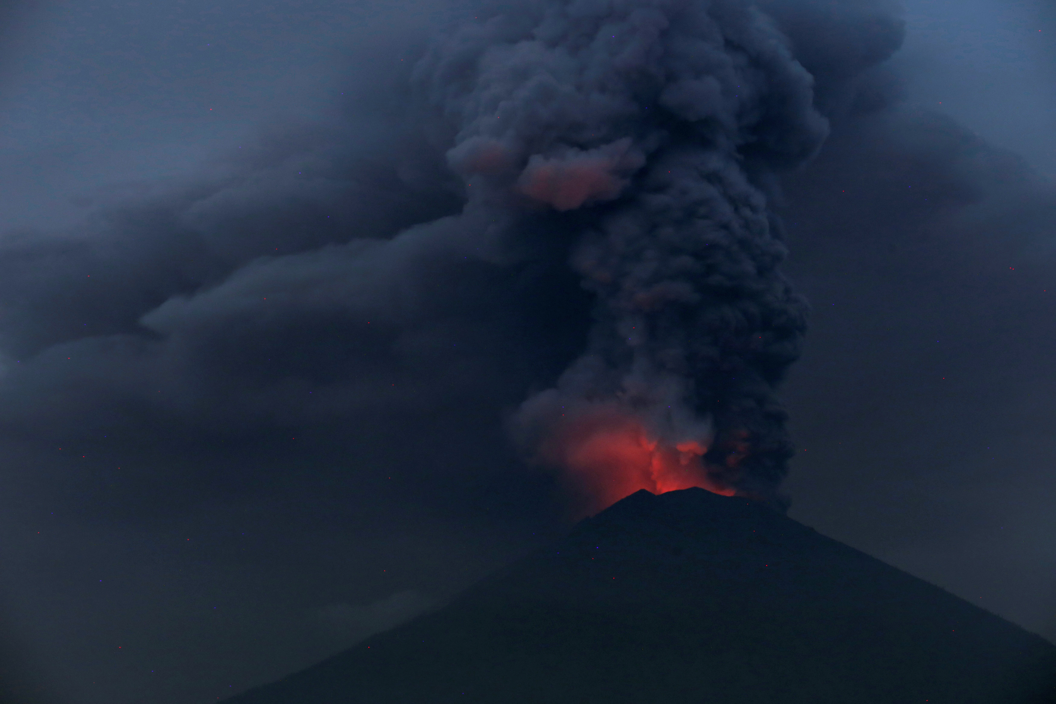 Glowing light of hot lava is seen during the eruption of Mount Agung as seen from Amed in Karangasem, Bali, Indonesia.