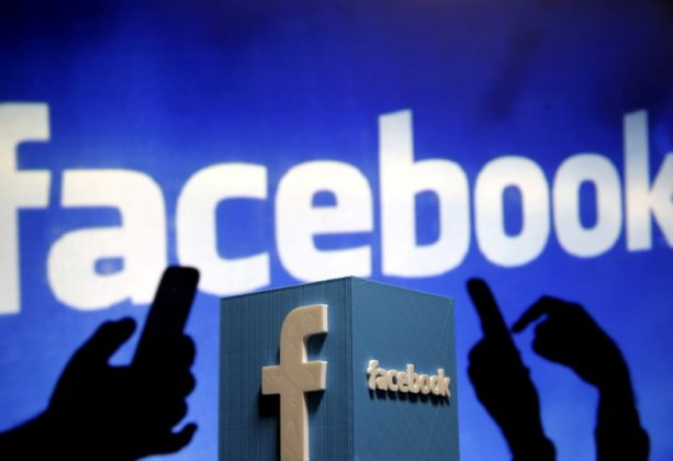 A 3D plastic representation of the Facebook logo is seen in this photo illustration