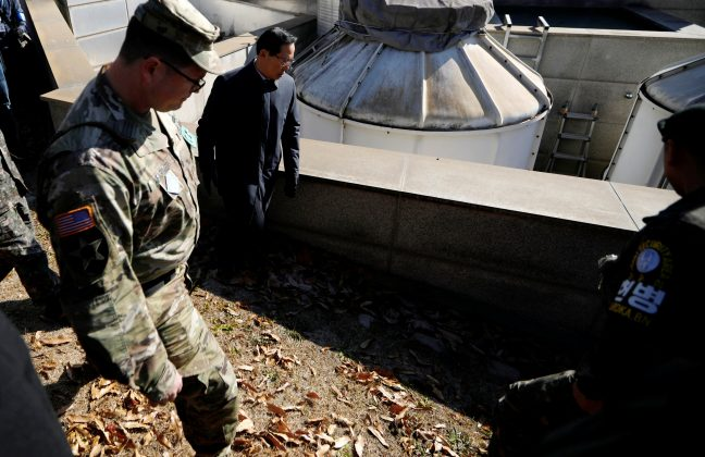 South Korean Defence Minister Song Young-moo looks around a spot where a North Korean collapsed wounded by gun shot by North Korean soldiers while crossing the border on November 13, at the truce village of Panmunjom inside the demilitarized zone, South Korea, November 27, 2017.