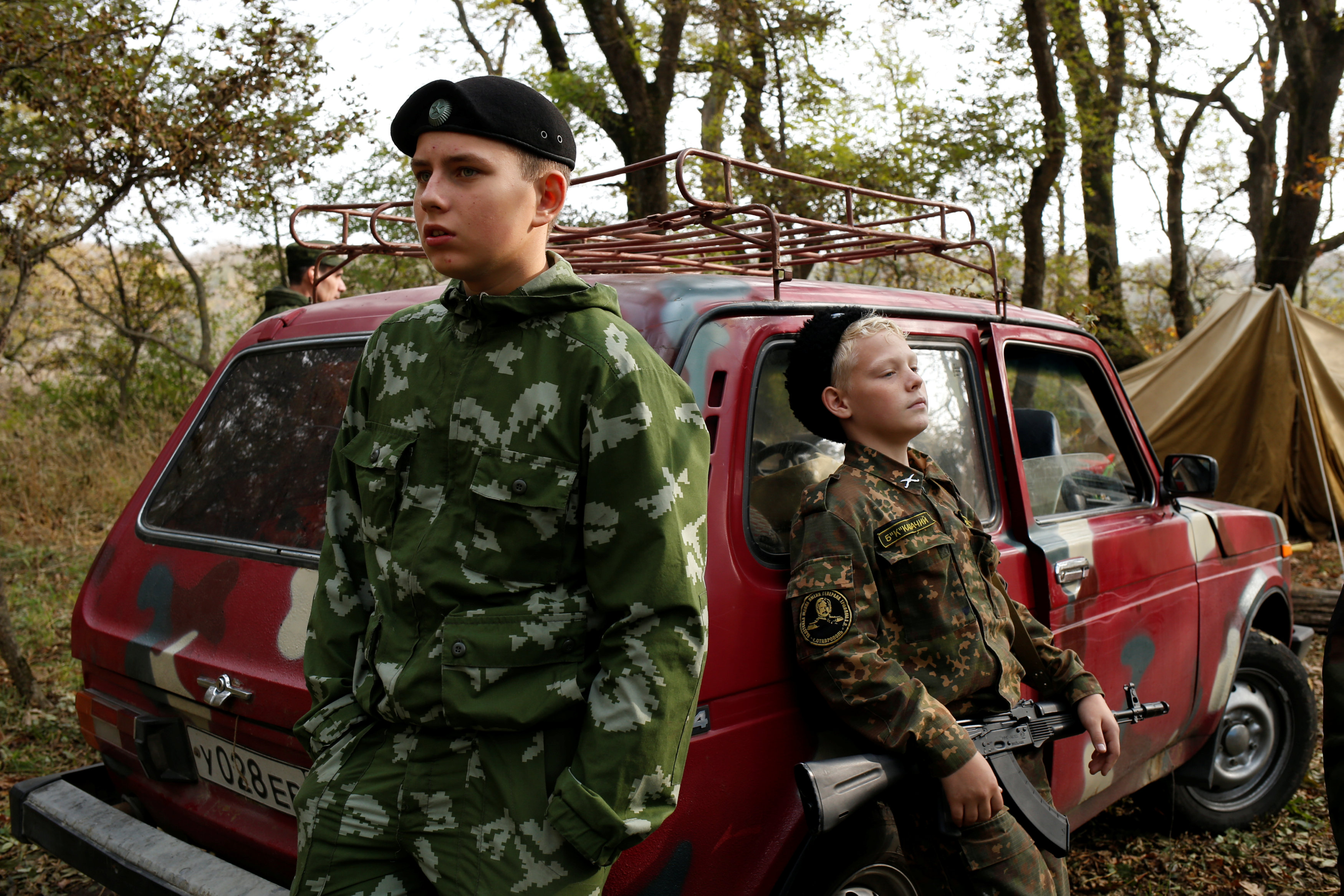 As West frowns on Putin, young Russians learn the military way