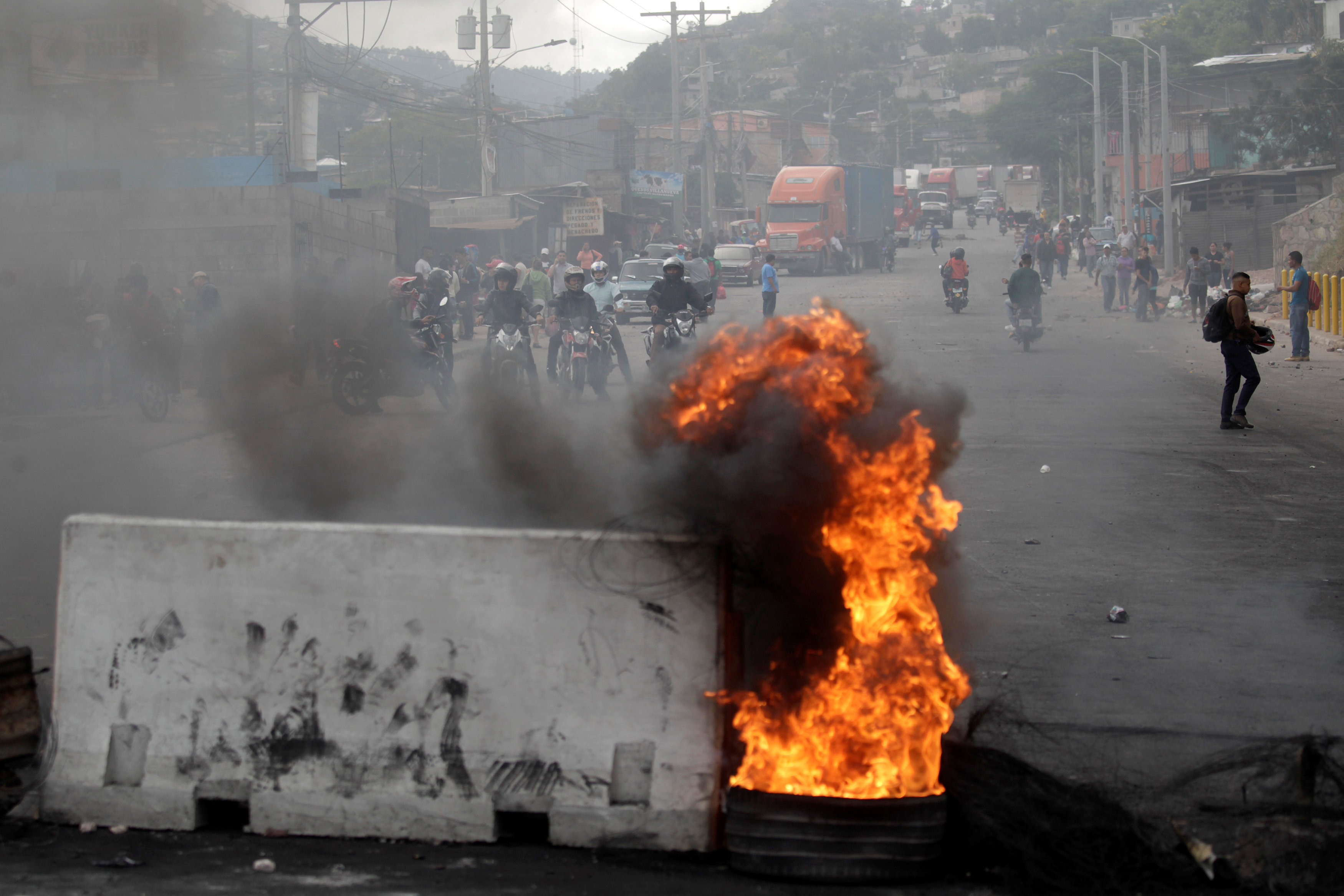 Honduras awaits presidential vote count as army enforces curfew