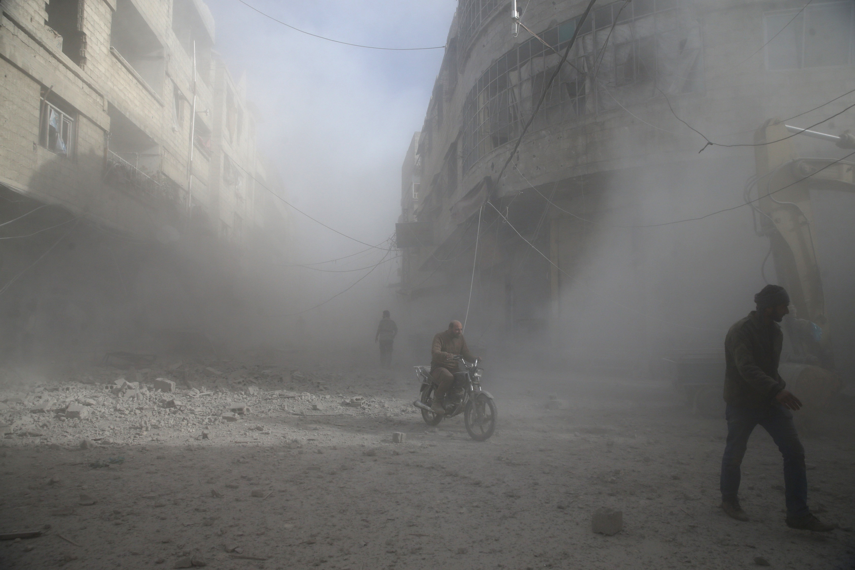 People are seen during shelling in the town of Hamoria, eastern Ghouta in Damascus, Syria, December 3,