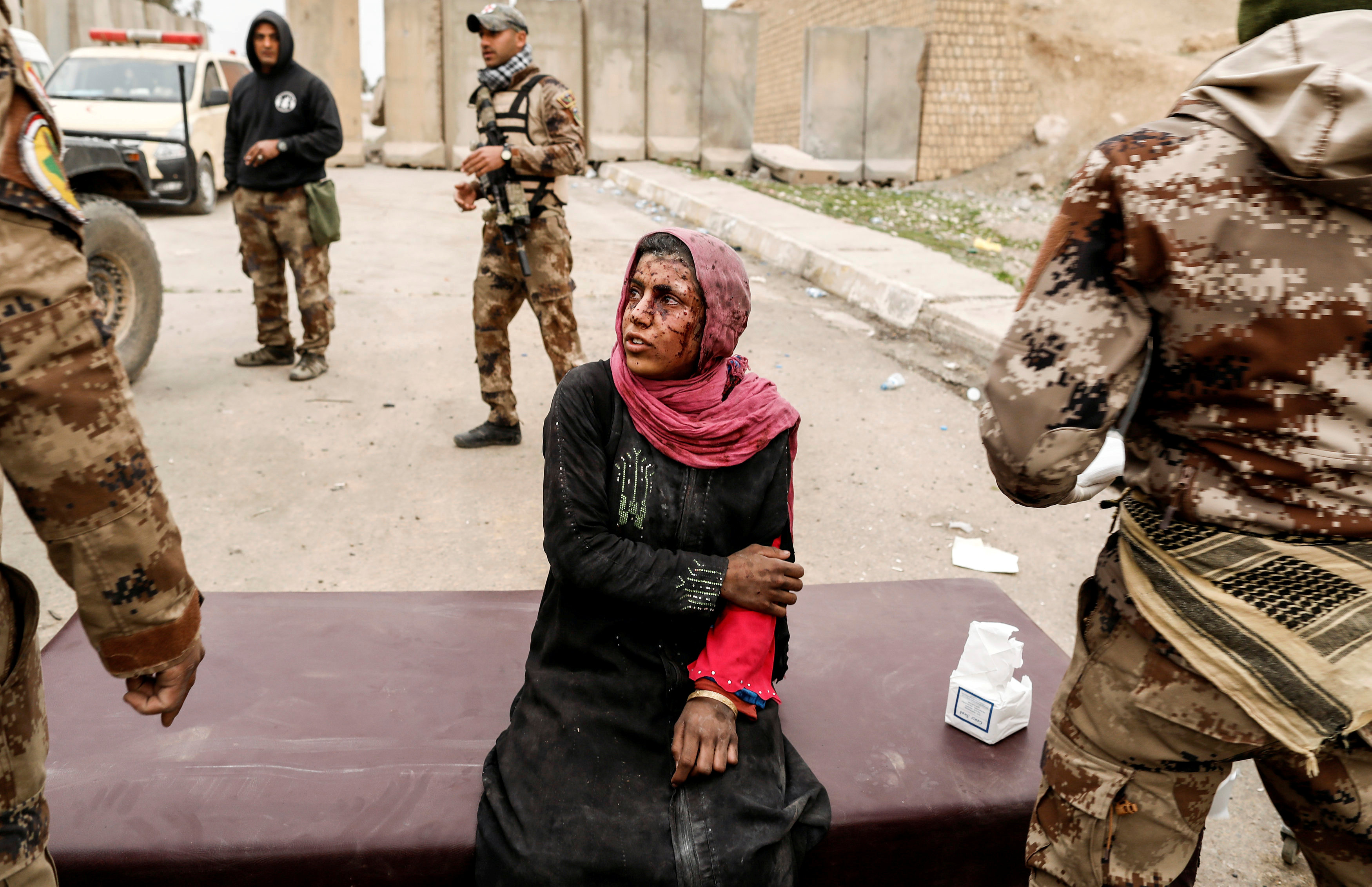 A woman injured in a mortar attack is treated by medics in a field clinic as Iraqi forces battle with Islamic State militants, in western Mosul, Iraq, March 2, 2017.