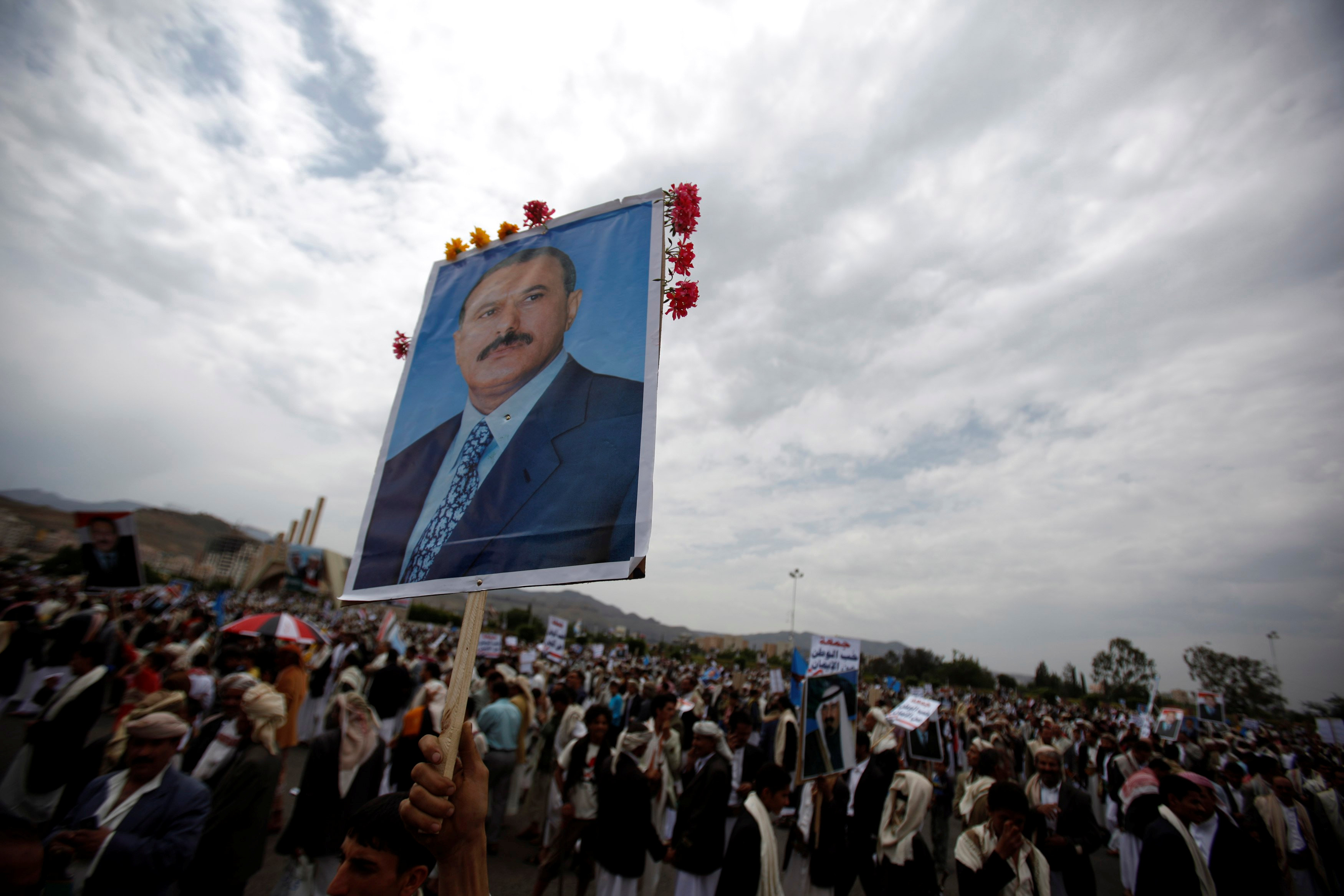 A supporter of Yemen's then President Ali Abdullah Saleh waves a poster featuring him during a rally to show support for him in Sanaa September 9, 2011.