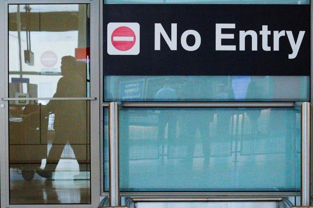 U.S. has begun fully implementing Trump travel ban: State Dept.