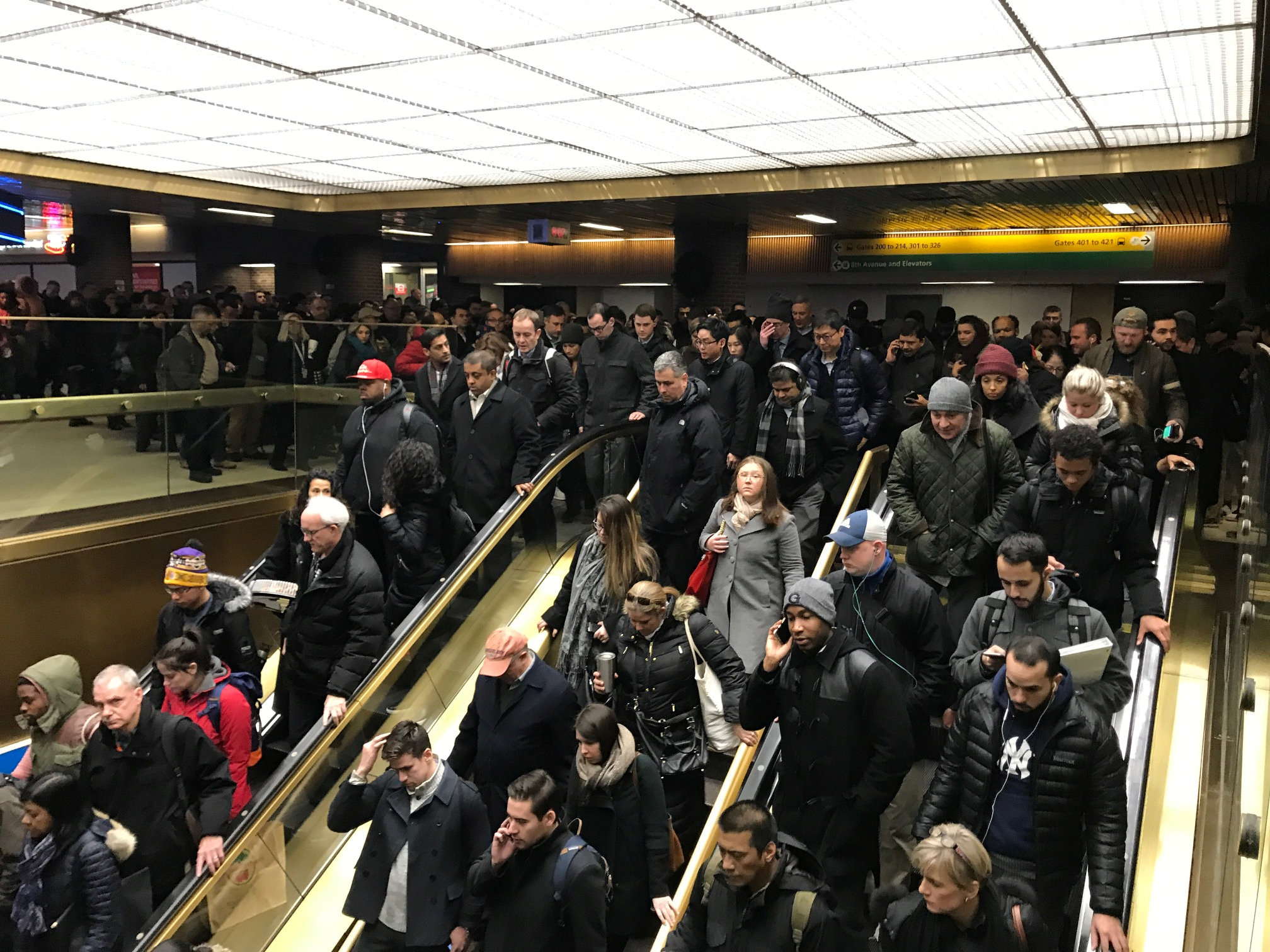 Commuters exit the New York Port Authority in New York City, U.S. December 11, 2017 after reports of an explosion.