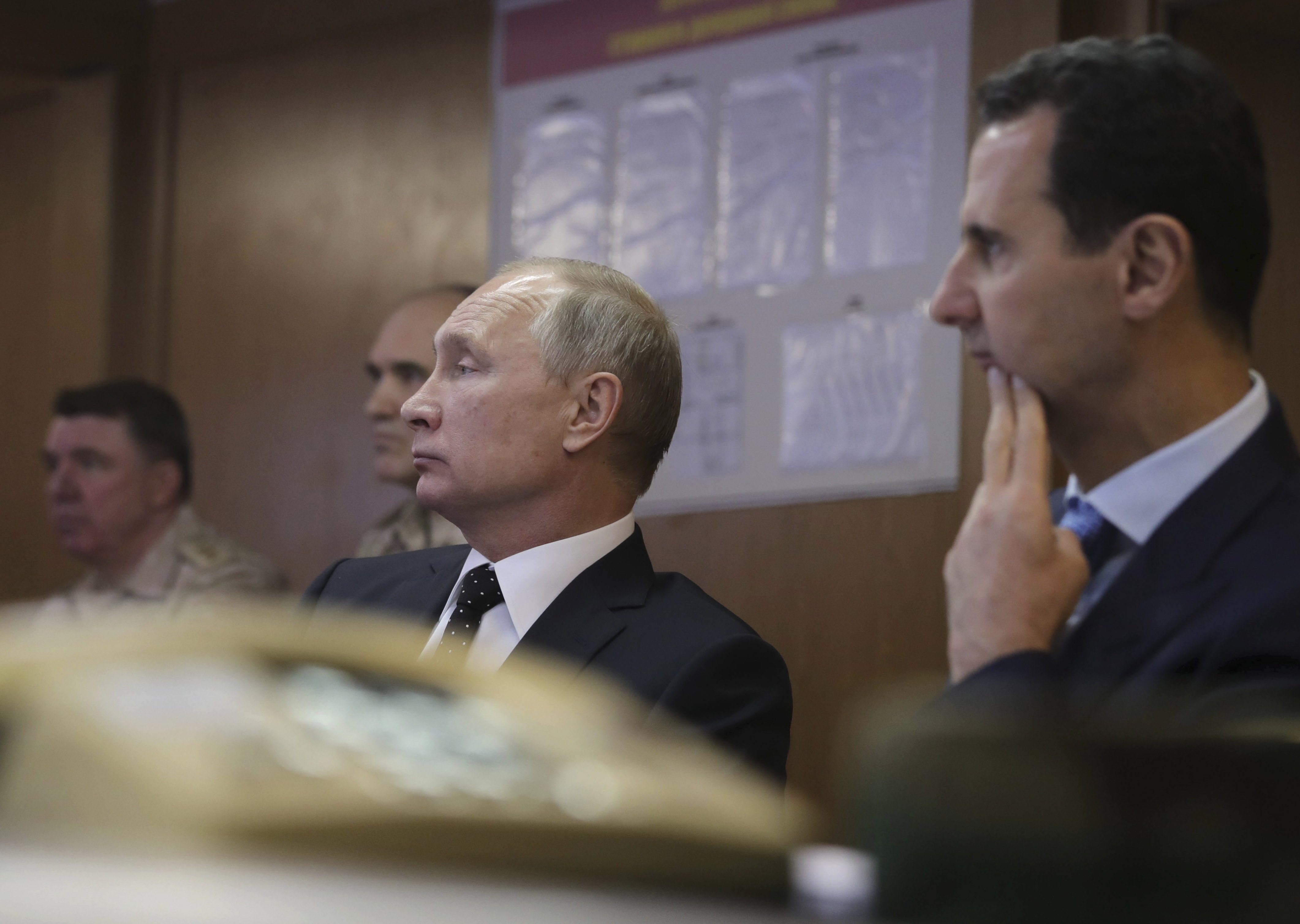 Russian President Vladimir Putin (2nd R) and Syrian President Bashar al-Assad (R) visit the Hmeymim air base in Latakia Province, Syria December 11, 2017.