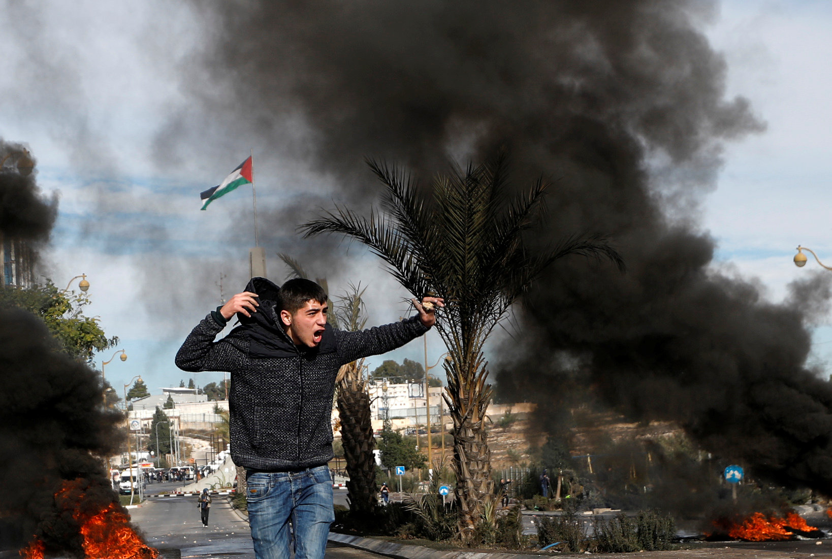 A Palestinian demonstrator shouts during clashes with Israeli troops at a protest against U.S. President Donald Trump's decision to recognize Jerusalem as the capital of Israel, near the Jewish settlement of Beit El, near the West Bank city of Ramallah December 11, 2017.