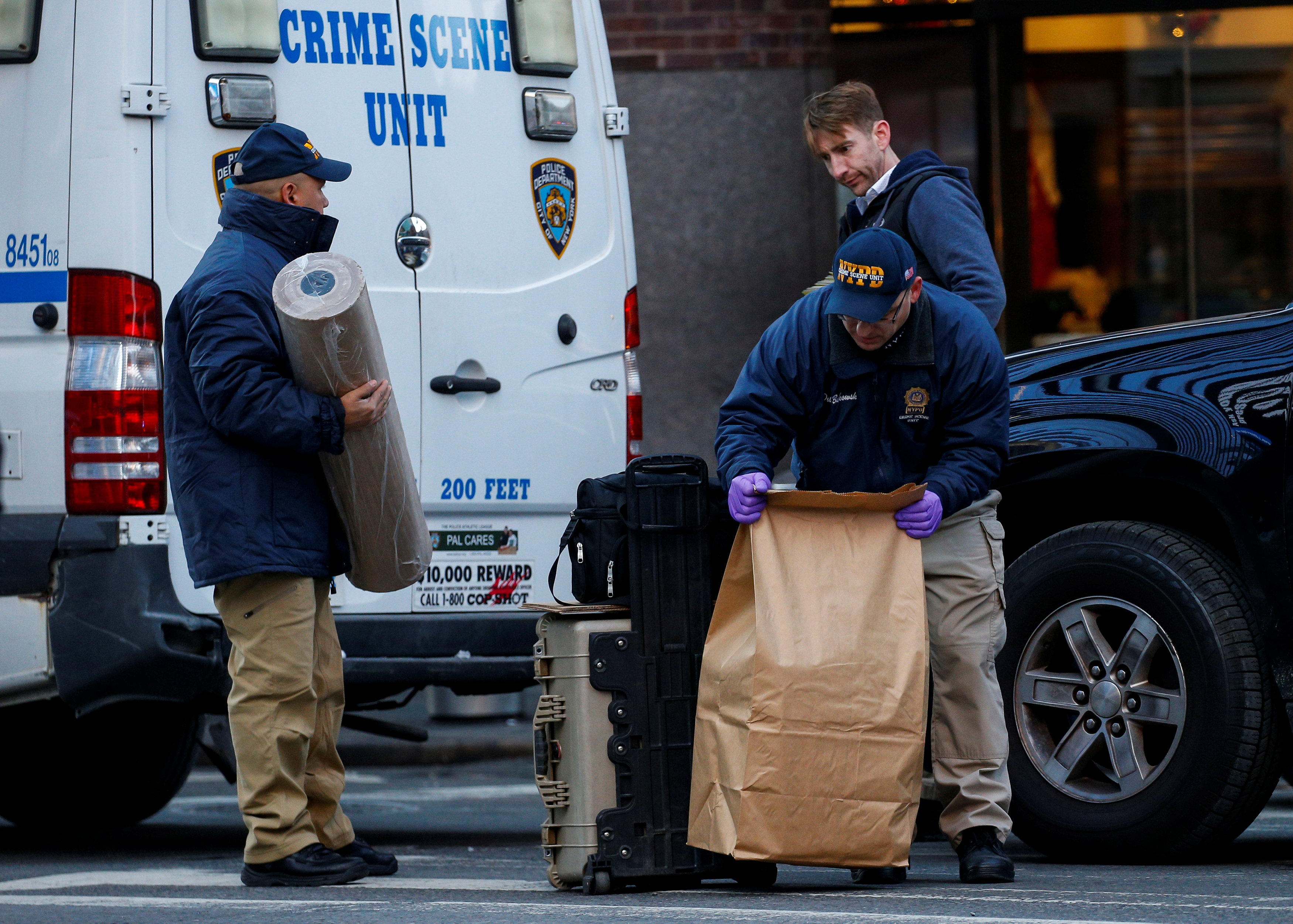 NYPD Crime Scene Investigation team are seen outside the New York Port Authority Bus Terminal, after reports of an explosion, in New York City, U.S., December 11, 2017.