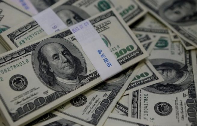 Dollar drops on disappointing U.S. inflation data