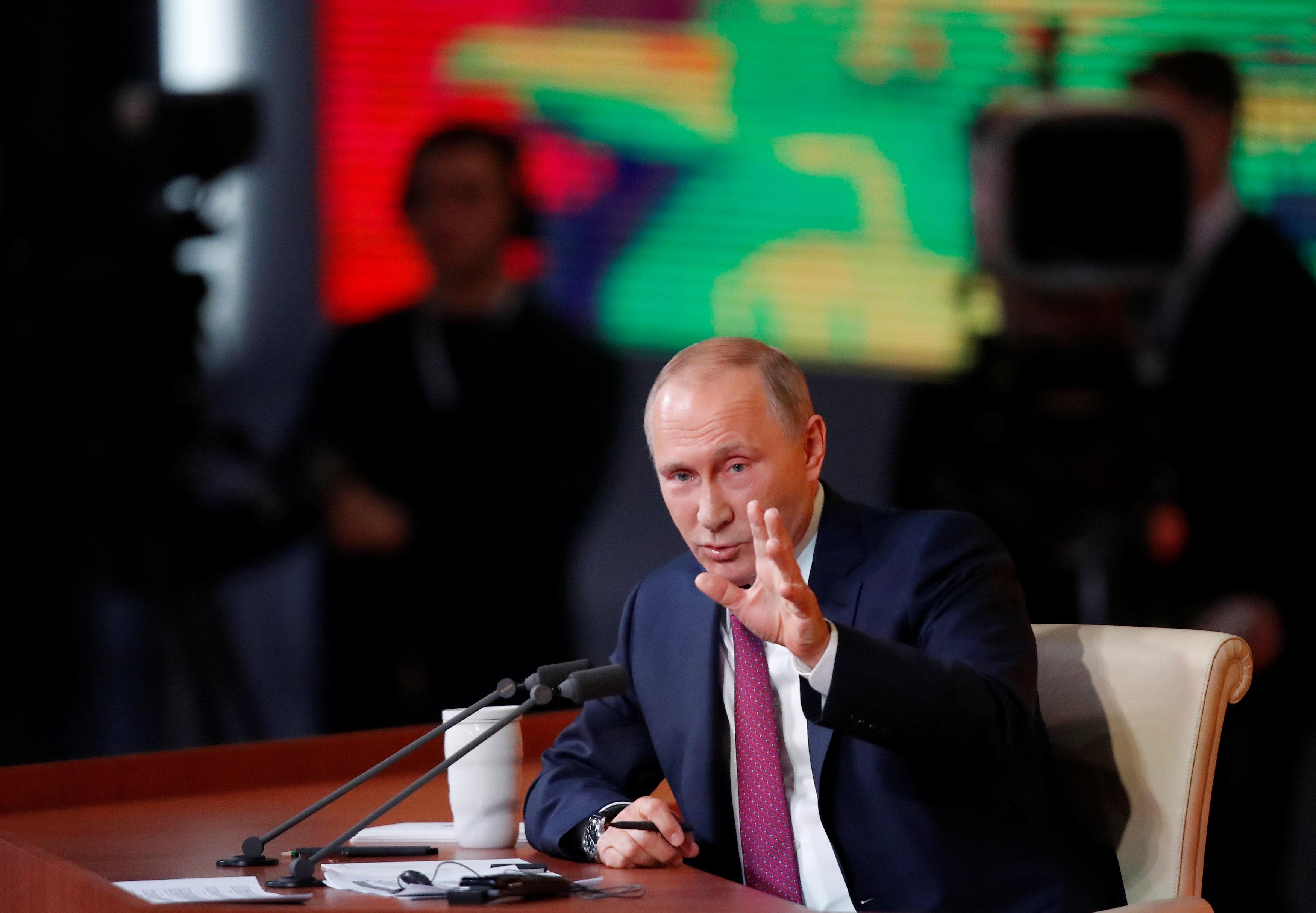 Putin says U.S. gripped by fabricated spymania, praises Trump