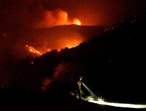 Firefighters keep watch on the Thomas wildfire in the hills and canyons outside Montecito, California, U.S., December 16, 2017.