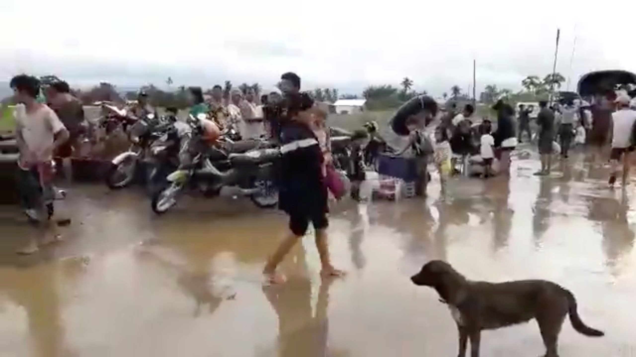 A general view shows search, retrieval, and relief operations ongoing at the flooded areas at Tzu Chi Village in Barangay Liloan, Phillipines, December 17, 2017 in this picture obtained from social media. ORMOC CITY POLICE OFFICE/via REUTERS