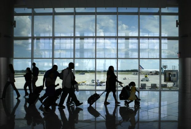 Passengers walk through the newly opened Maynard H. Jackson Jr. International Terminal at Hartsfield-Jackson Atlanta International Airport in Atlanta, Georgia May 16, 2012.