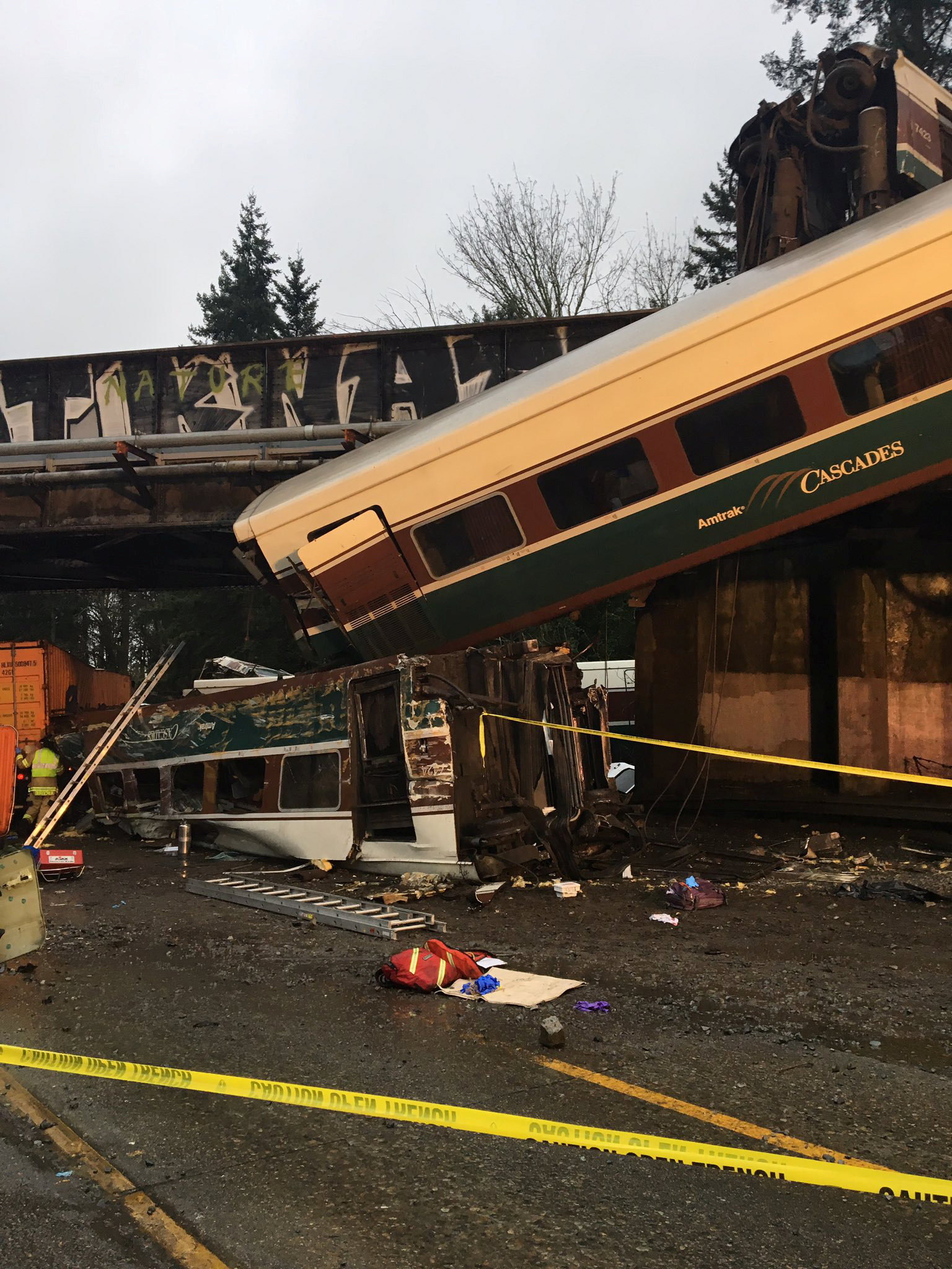 An Amtrak passenger train derailment over interstate highway (I-5) is seen in this Washington State Patrol image moved on social media in DuPont, Washington, U.S., December 18, 2017.
