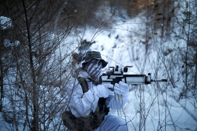 South Korean and U.S. Marines take part in a winter military drill in Pyeongchang, South Korea, December 19, 2017. REUTERS/Kim Hong-Ji