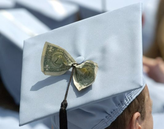 Graduates celebrate receiving a Masters in Business Administration from Columbia University during the year's commencement ceremony in New York in this May 18, 2005 file photo. dreams of many college seniors. REUTERS/Chip East/Files
