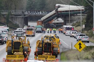 Rescue personnel and equipment are seen at the scene where an Amtrak passenger train derailed on a bridge over interstate highway I-5 in DuPont, Washington, U.S., December 18, 2017.