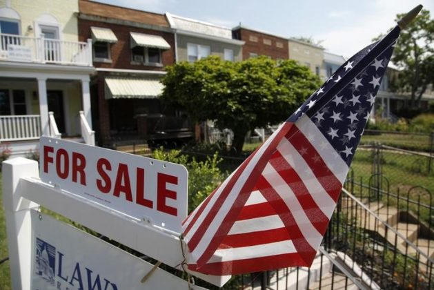 A U.S. flag decorates a for-sale sign at a home in the Capitol Hill neighborhood of Washington, August 21, 2012.