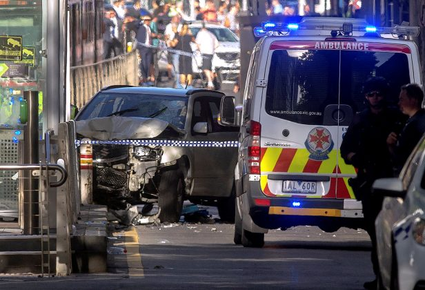 Australian police stand near a crashed vehicle after they arrested the driver of a vehicle that had ploughed into pedestrians at a crowded intersection near the Flinders Street train station in central Melbourne, Australia December 21, 2017.