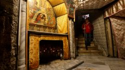 A visitor walks in the cave, where Virgin Mary is believed to have given birth to Jesus, inside the Church of the Nativity in the West Bank town of Bethlehem December 12, 2017.