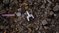 A used container of the drug Narcan used against opioid overdoses lies on the ground in a park in the Kensington section of Philadelphia, Pennsylvania, U.S. October 26, 2017. REUTERS/Charles Mostoller