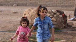 Yazidi girls Suhayla, 12, and Rosa, 13, who were reunited with their family after being enslaved by Islamic State militants, walk at Sharya Camp in Duhuk, Iraq December 18,