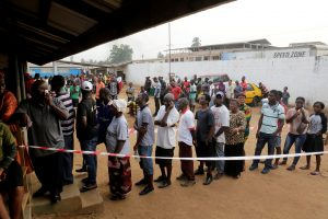 People wait to vote during the presidential election at a polling station in Monrovia, Liberia December 26, 2017.