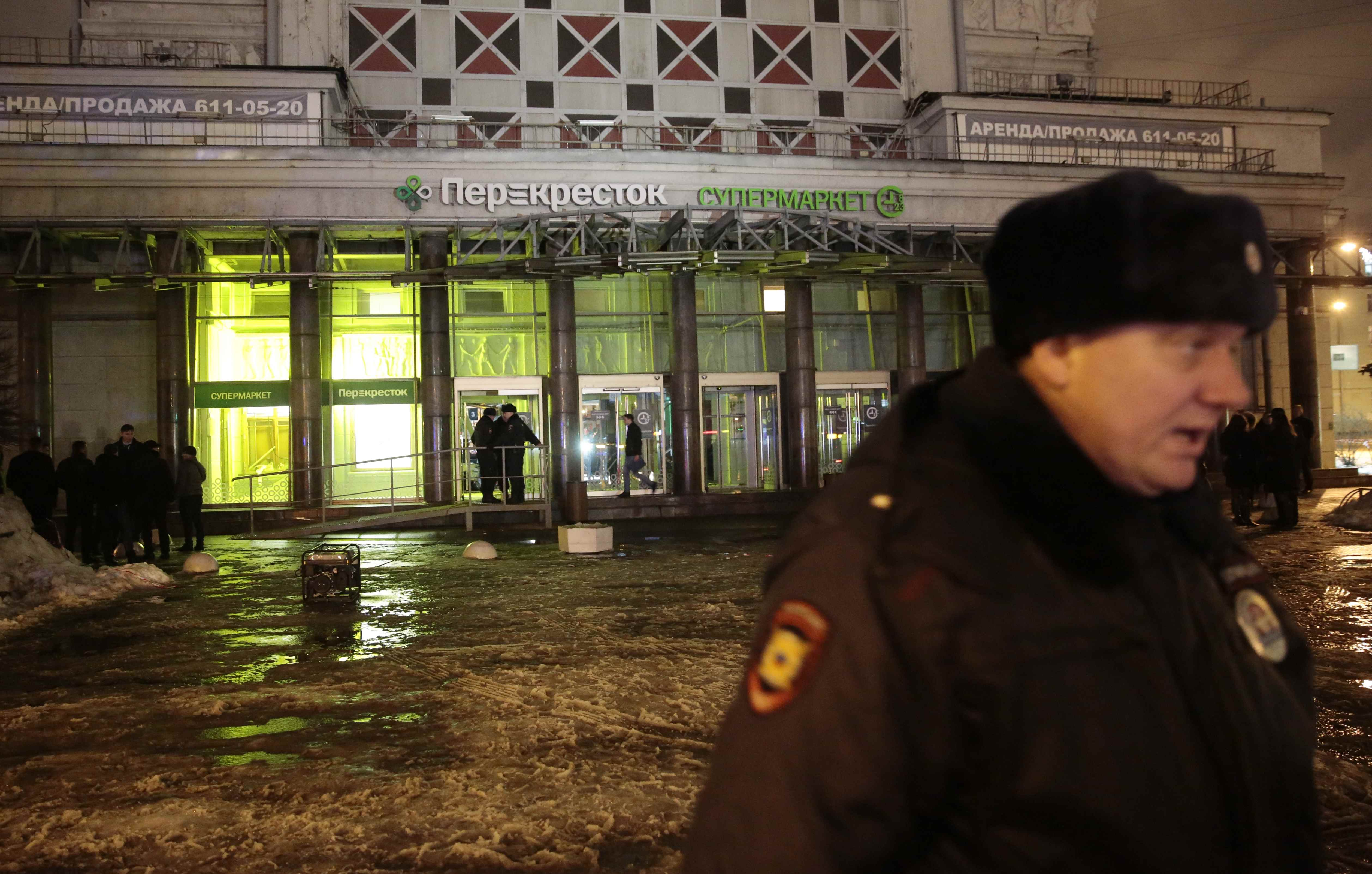 A policeman stands guard near a supermarket after an explosion in St Petersburg, Russia December 27, 2017.