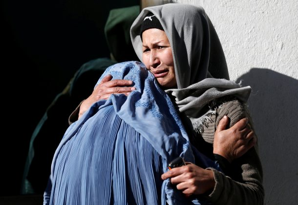 Afghan women mourn inside a hospital compound after a suicide attack in Kabul, Afghanistan December 28, 2017.