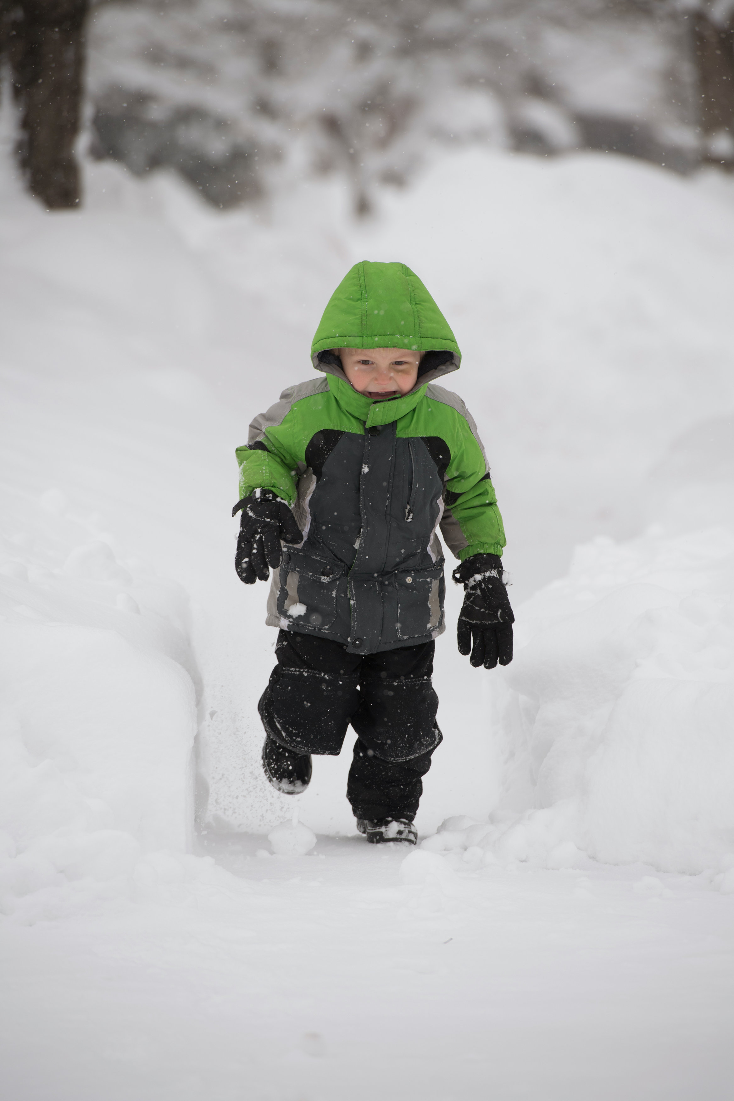 Silas Stueve plays in the snow after two days of record-breaking snowfall in Erie, Pennsylvania, U.S., December 27, 2017.