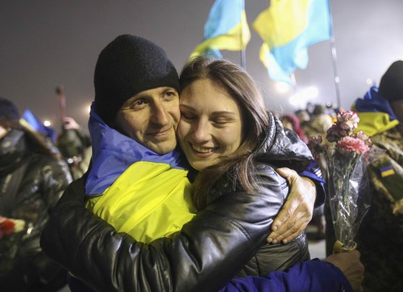 A recently exchanged prisoner of war (POW) from the Ukrainian armed forces is embraced upon his arrival at Boryspil International airport outside Kiev, Ukraine December 28, 2017.