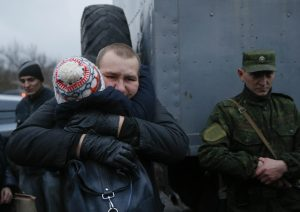 A prisoner (back) of war (POW) from the Ukrainian armed forces is embraced during the exchange of captives in Horlivka in Donetsk region, Ukraine December 27, 2017.