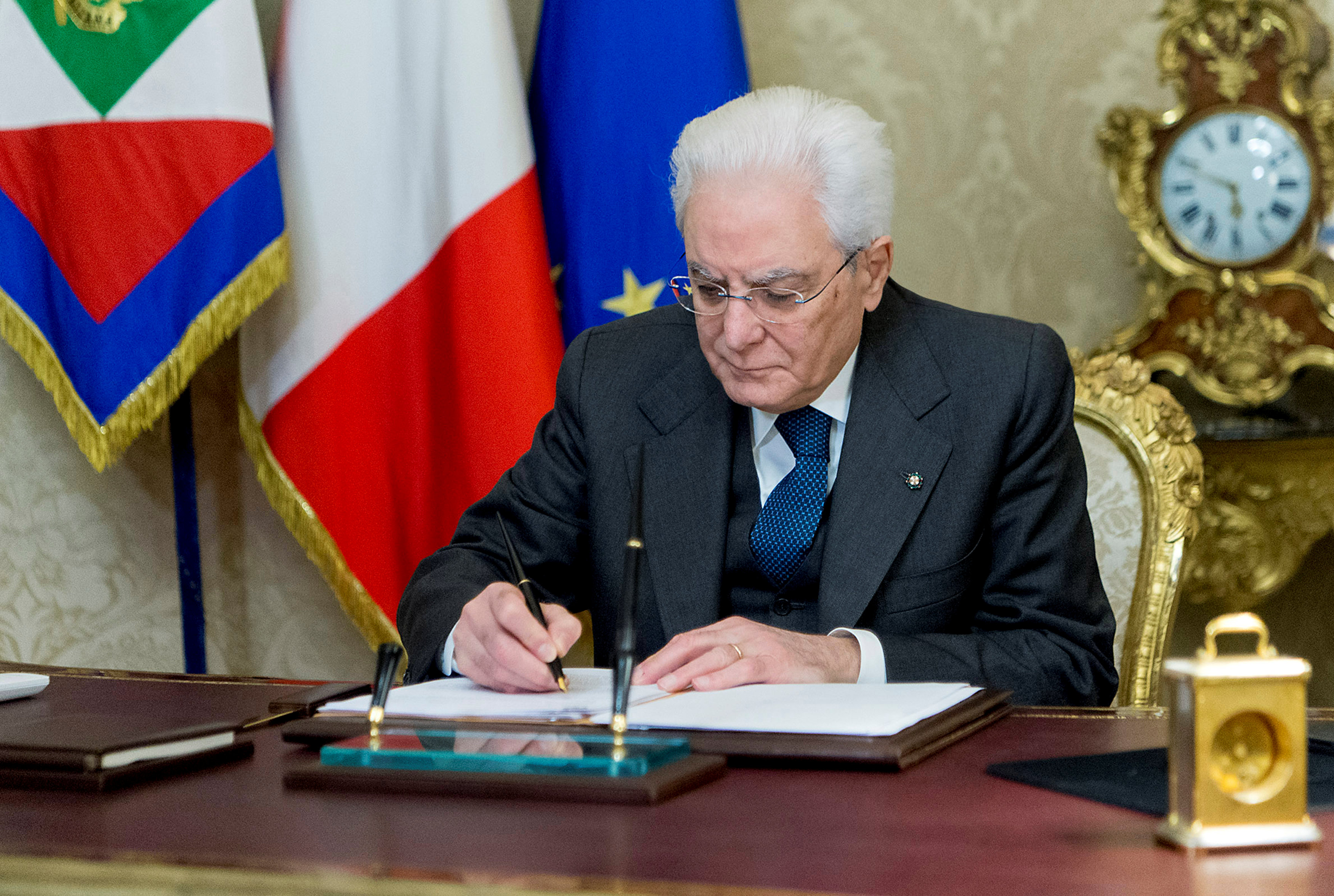 Italian President Sergio Mattarella signs a decree to dissolve parliament at the Quirinale Presidential palace in Rome, Italy,