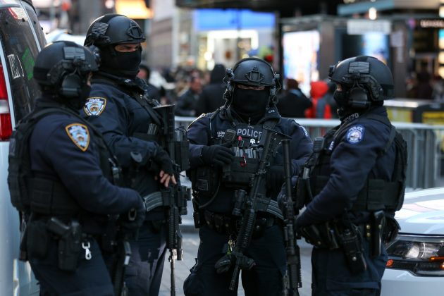 New York Police Department Counterterrorism Bureau members stand in Times Square to provide security ahead of New Year's Eve celebrations in Manhattan, New York, U.S. December 28, 2017