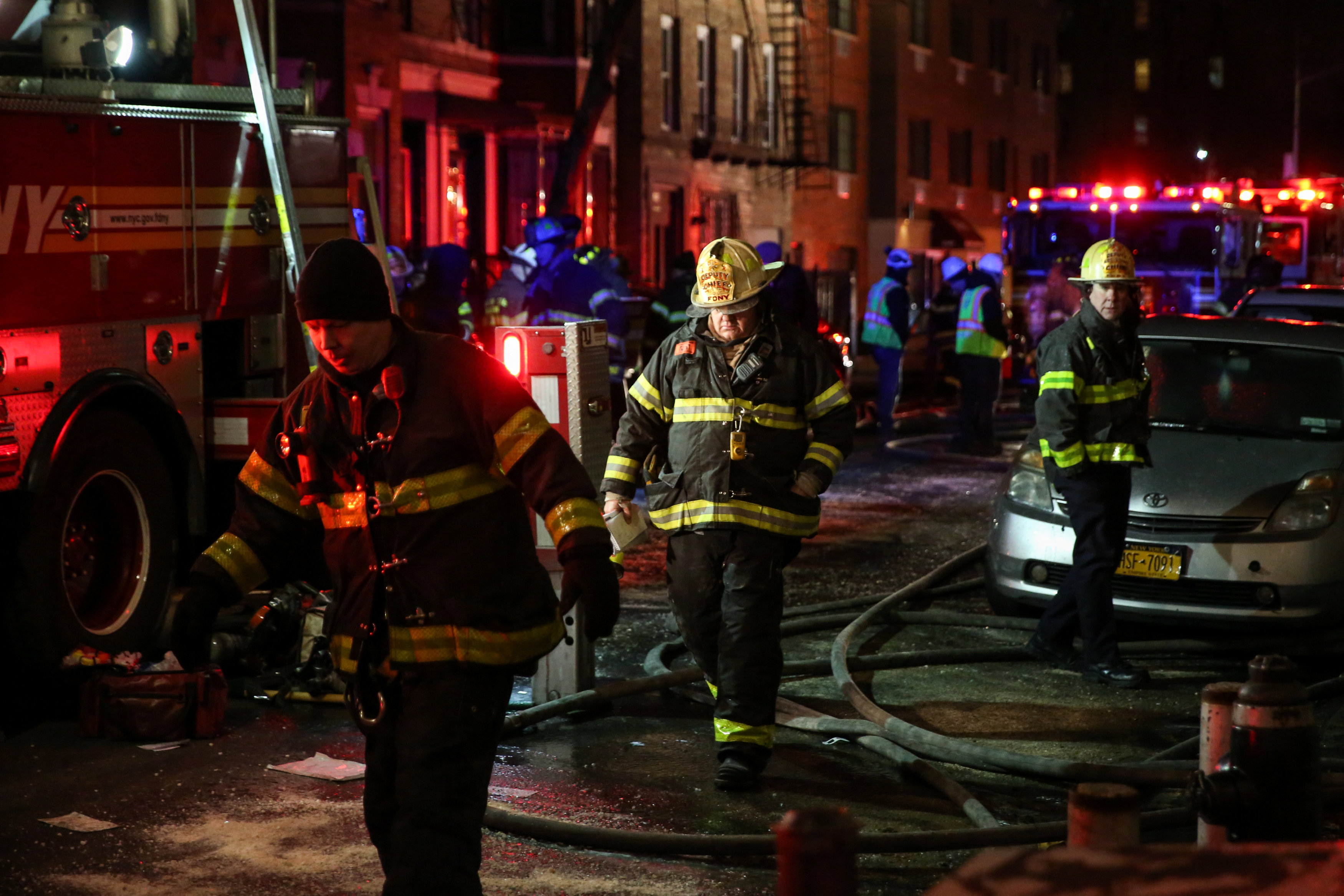Fire Department of New York (FDNY) personnel work on the scene of an apartment fire in Bronx, New York, U.S., December 28, 2017.