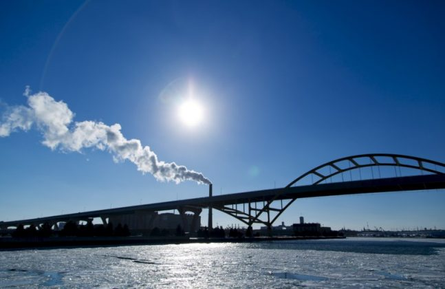 Steam is seen drifting from a factory over the Hoan Bridge in Milwaukee, Wisconsin, in this February, 6, 2014 file photo.