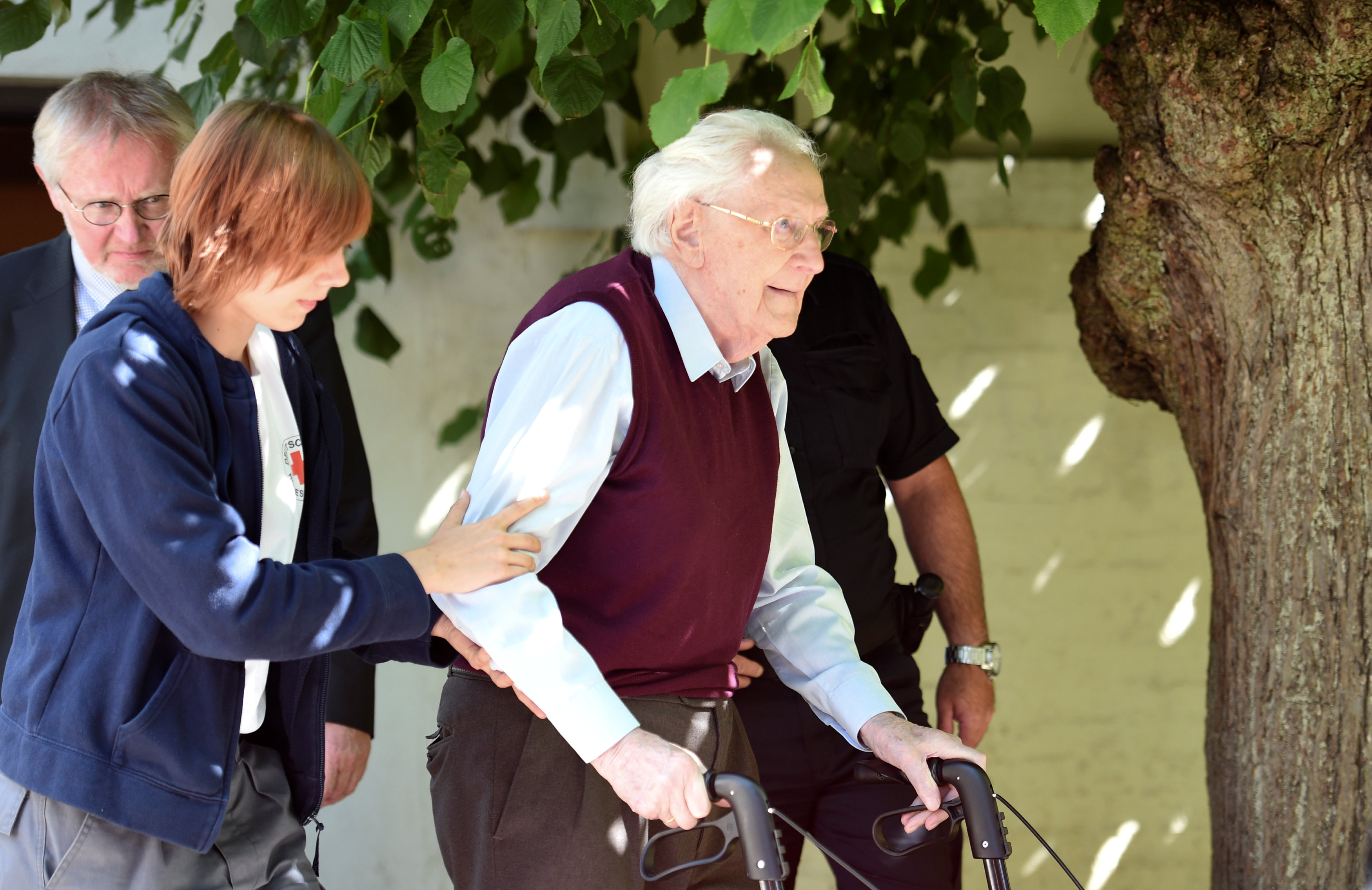 "Oskar Groening, defendant and former Nazi SS officer dubbed the ""bookkeeper of Auschwitz"" leaves the court after the announcement of his verdict in Lueneburg, Germany, July 15, 2015."