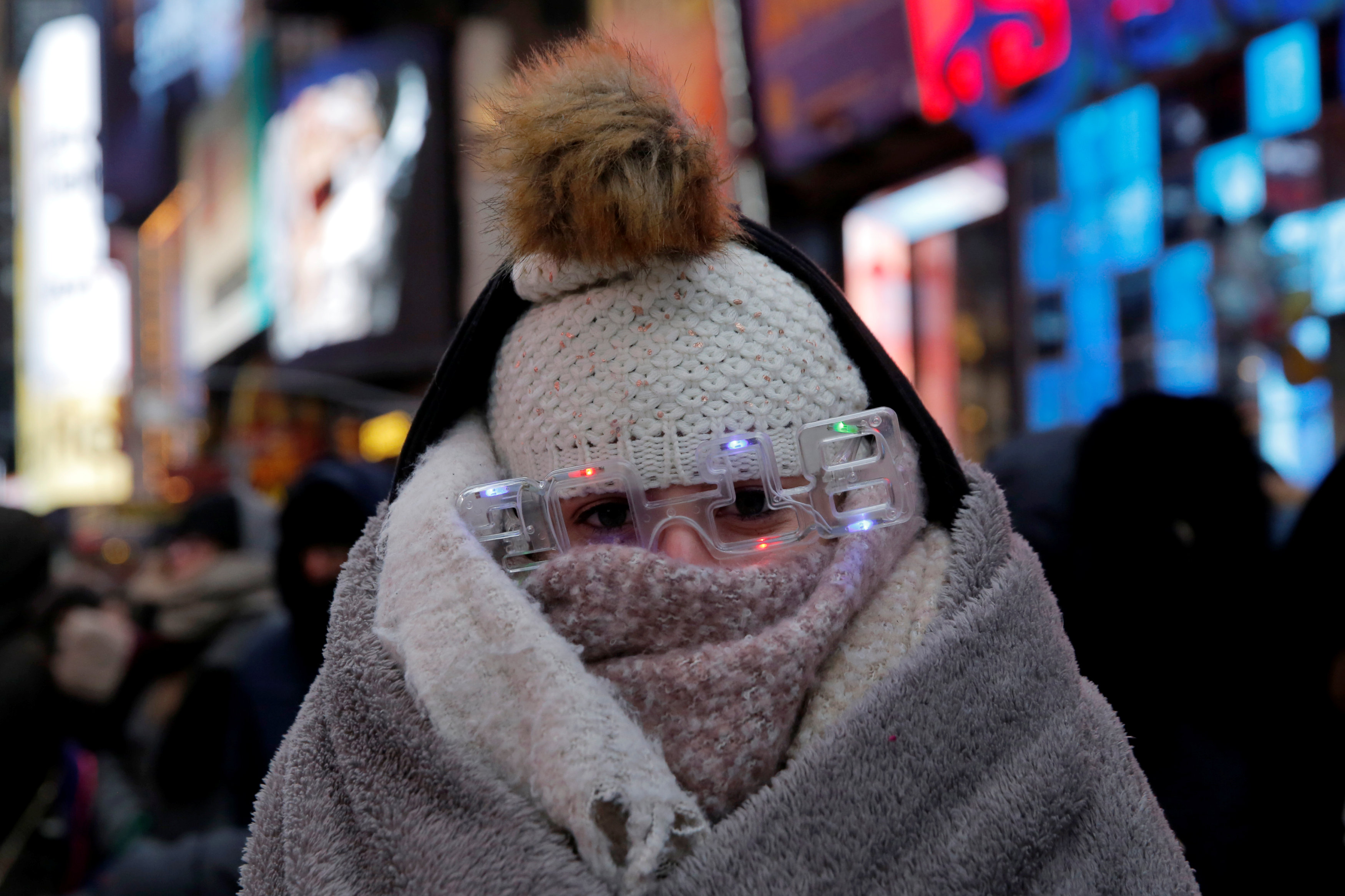 Elena Barduniotis from Colorado waits in Times Square ahead of New Year's celebrations in Manhattan.